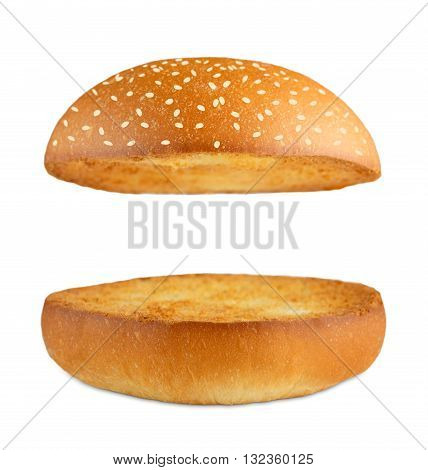 American food classic burger round bun with sesame isolated at white background. Burger bun without ingredients.