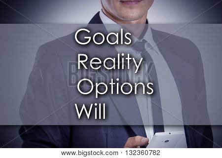Goals Reality Options Will Grow - Young Businessman With Text - Business Concept