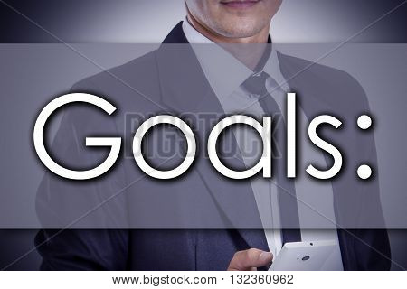 Goals: - Young Businessman With Text - Business Concept