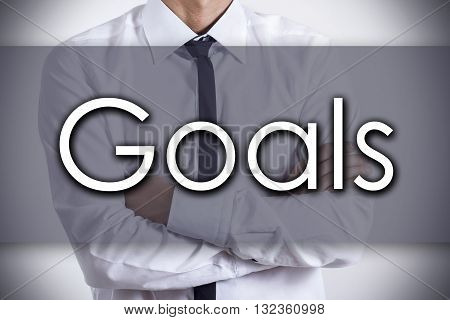 Goals - Young Businessman With Text - Business Concept