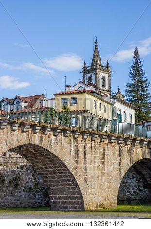 Roman Bridge In Front Of A Church In Ponte Da Barca