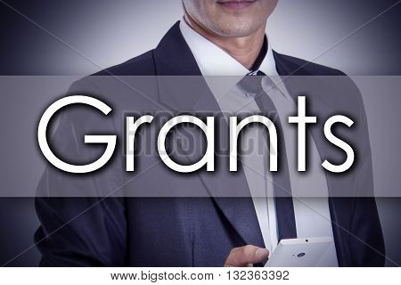 Grants - Young Businessman With Text - Business Concept