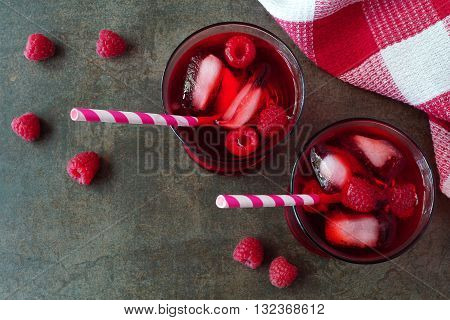 Raspberry Fruit Drinks In Glasses With Straws, Overhead View On A Stone Background
