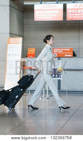 Asian Flight Attendant In The International Airport Of Incheon