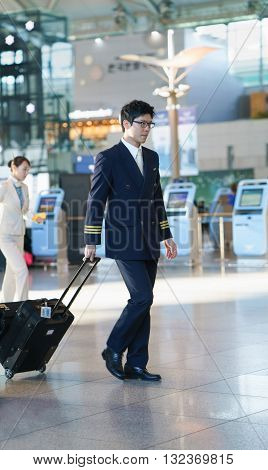 Asian Male Pilot At The Incheon International Airport