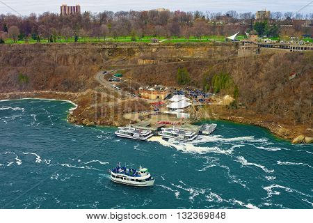 Boat In Niagara River And View Of Ontario In Canada