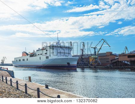 Ferry On The Venta River In Ventspils In Latvia