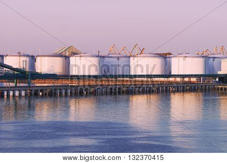Oil Bunkers At The Marina In Ventspils At Sunset