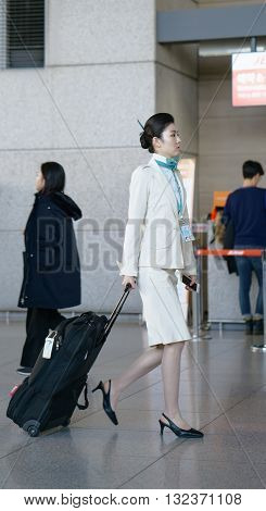 Asian Female Air Flight Attendant In The Incheon International Airport