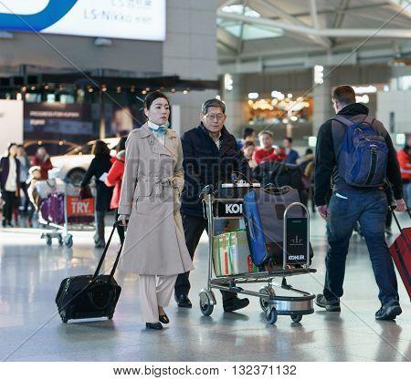 Asian Female Flight Attendant At The Incheon International Airport