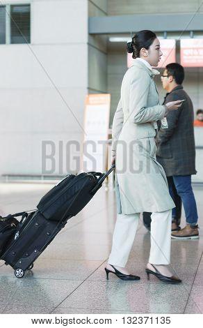 Asian Female Flight Attendant In International Airport Of Incheon