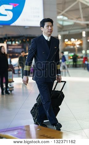 Asian Male Flight Attendant In The Incheon International Airport