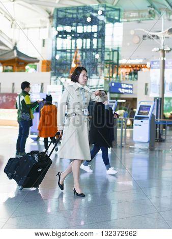 Asian Flight Attendant At International Airport Of Incheon