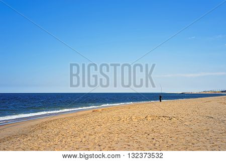 Man Fishing At Atlantic Ocean Shore At Sandy Hook