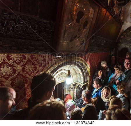Bethlehem, Israel - February 19, 2013: Pilgrims Praying In Church Of The Nativity