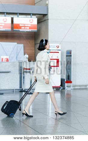 Asian Korean Air Flight Attendant At International Airport Of Incheon