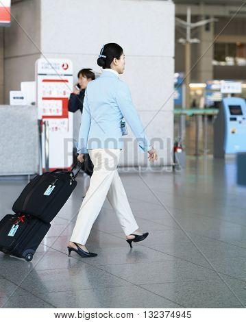 Asian Air Flight Attendant In Incheon International Airport