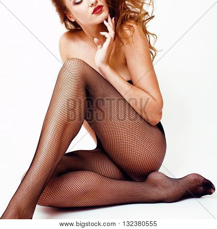Sexy young real woman in black pantyhose and lingerie, red lips, sexy look isolated on white
