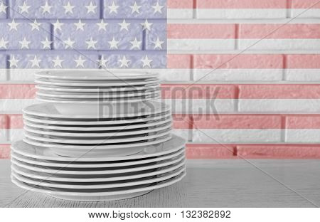 Stacked white dishes on table. American cuisine food concept