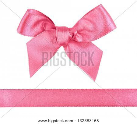 Pink satin bow and ribbon isolated on white