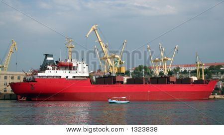 The Red Tanker In Harbour.