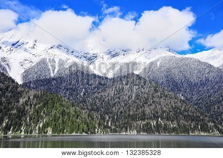 Mountains by Ritsa lake at winter day time. Abkhazia. Caucasus.
