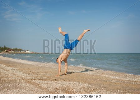Young Man Jumping On Beach