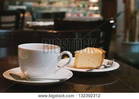 Coffee Cup And Cheesecake In Coffee Shop