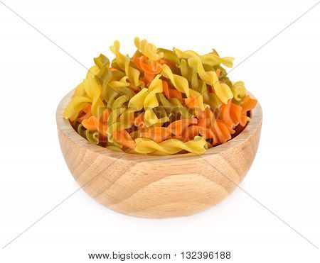 small vegeroni Rotini spirals pasta in wooden bowl on white background