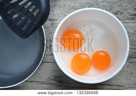 raw eggs and pan and  flipper  in kitchen