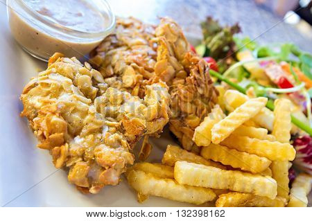 Deep-fried Fish Steaks With Almond Flakes And Friend Fried