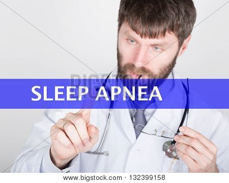 technology, internet and networking in medicine concept - medical doctor presses sleep apnea button on virtual screens. Internet technologies in medicine.