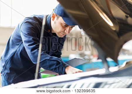 Mechanic working in his workshop