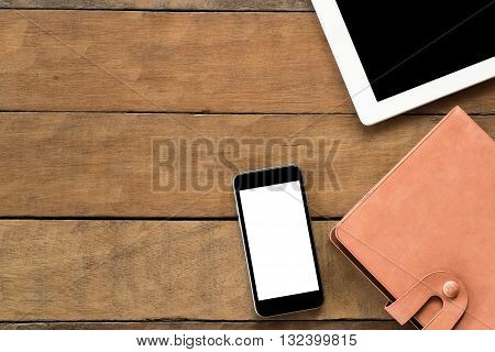 Office desk with blank screen smartphone leather notebook and tablet . Flat lay photo.Top view with copy space