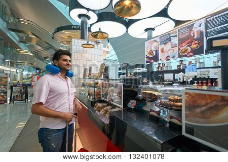 DUBAI, UAE - MARCH 09, 2016: customer at Costa Coffee in Dubai International Airport. Costa Coffee is a British multinational coffeehouse company.