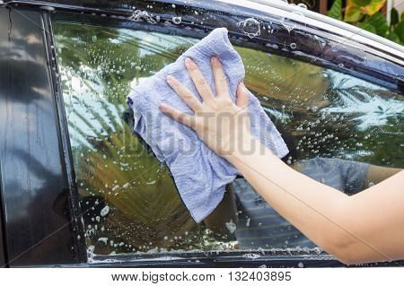 Woman Hands Washing A White Car