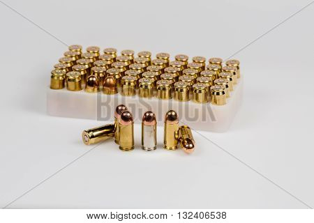 bullets and ammo for handgun, and smashed bullets showing the force