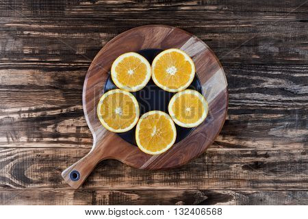 Five Slices Of Orange On Chopping Board. Top View With Copy Space