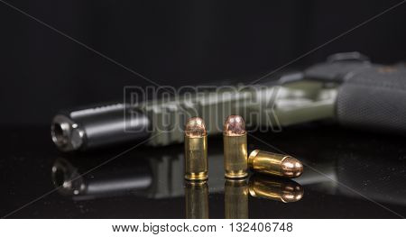 handgun muzzle and smashed bullet, ammoniation with blackground