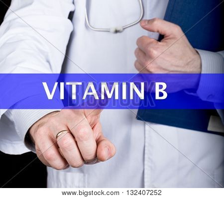 technology, internet and networking in medicine concept - medical doctor presses vitamin b button on virtual screens. Internet technologies in medicine.