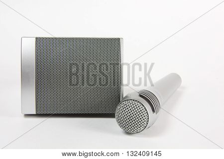 Components of sound-amplifying equipment microphone speaker sound reinforcement speech music components electronics equipment silver background white