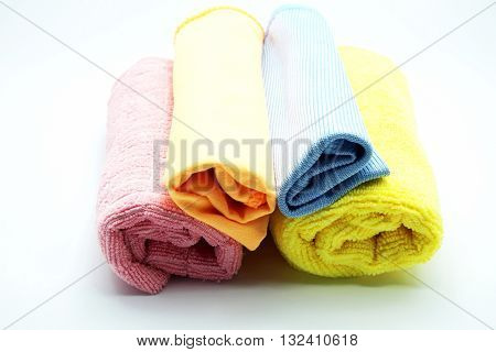Closeup pile of colorful microfiber towel/cloth for car wipe with role pattern on gray-white background. Focus on head rolls.
