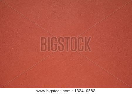 red texture of shabby paint and plaster cracks