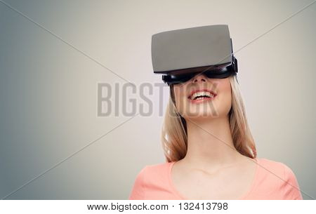 technology, virtual reality, entertainment and people concept - happy young woman with virtual reality headset or 3d glasses over gray background