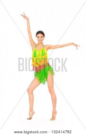Beautiful professional female dancer dancing at studio. Latin American dances. Isolated over white.