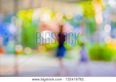 Image Fo Blur People Walking At  Walkway With Open Space To Green Garden