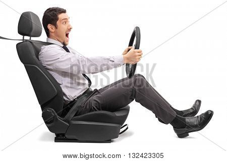 Excited young man driving fast and enjoying himself isolated on white background