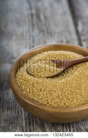 Cane Sugar In A Wooden Bowl Close-up
