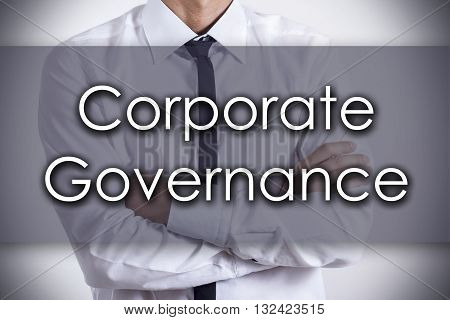 Corporate Governance - Young Businessman With Text - Business Concept