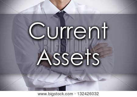 Current Assets - Young Businessman With Text - Business Concept